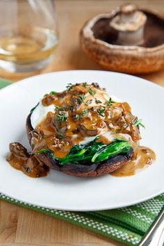 Roasted Portobello Mushroom with Poached Egg in a Creamy Mushroom Sauce- I don't even like mushrooms and this looks good