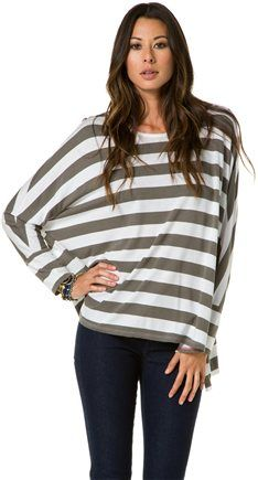 I have that shirt, I was wondering how to wear it. Sadly that picture don't give complete style view. Maybe with leggings (my shirt is a little longer) and riding boots :).