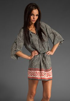 I love this tunic, but it's NOT a dress, so I would have some white skinny jeans underneath!