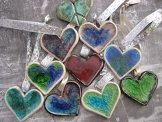 Heart Christmas Ornament - marbles melted in clay hearts. This is so COOL! I want to try this.