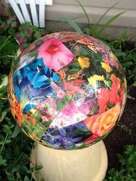 Bowling ball covered with magazine clippings - applied with Mod Podge. Use outdoor Mod Podge or polyurethane to seal it. #gardenartideas #recycled #gardenballs  source img