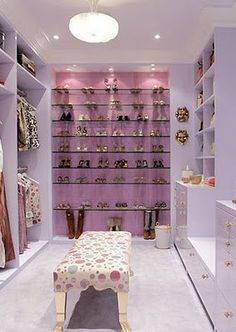 Closet with drawer units, mirror, and shoe shelves