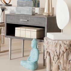 Dario double Side Table by Made Goods in Cool Gray features opulent faux shagreen. Silver metal legs bring texture to this ultra stylish and functional piece.