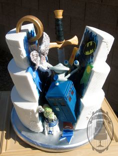 Nerdy wedding cake, with tardis, one ring, games of thrones, r2d2, Serenity, enterprise!