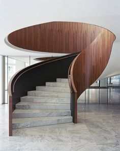 Rotterdam office foyer remodelled with marble and dark wood to resemble a hotel lobby.