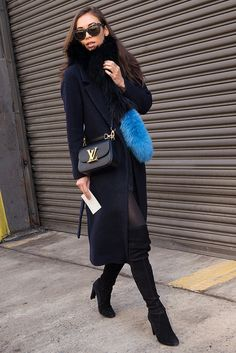 We want those boots, and the coat, and the Charlotte Simone scarf, and the Louis bag...We want everything from this look! I guess Rumi Neely has got it all. #NYFW #streetstyle #styletone