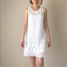 ✳️Best white  summer dress crochet hollow w lining Best white modern summer dress. Tasteful and fun . Patchwork crochet cutout outer shell with inner lining. 100% poly . Hand wash old no dry clean Dresses Midi