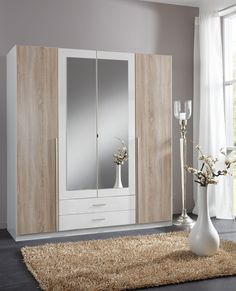 Large 4 door wardrobe with 2 drawers in white with oak effect doors. The oak and white is a excellent combination and will complement most modern Tv Unit Furniture, Wardrobe Furniture, Furniture Catalog, Bedroom Furniture, Furniture Design, 4 Door Wardrobe, Wooden Wardrobe, Mirrored Wardrobe, Bedroom Wardrobe