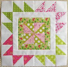 Pinwheel within a Star Quilt Block, tutorial at http://haniesquilts.blogspot.com/2012/03/sew-red-for-women-block-2.html