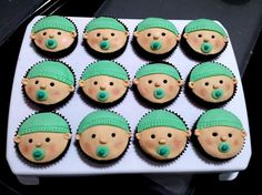 Baby Shower Cupcake Idea ... Baby Cupcakes with Blue & Green Colors (Caleb's Favorite Colors) ... Different Alternating Blue & Greens Icing Pattern Hats and Mini Blue & Green Pacifiers, Chocolate Cupcake, Peanut Butter Icing for Face, & Mini Chocolate Chips for Eyes