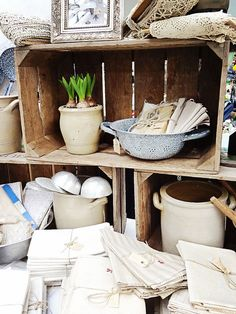 Love the use of crates for display   (at antique market in Utrecht – www.fleurslinnen.nl)