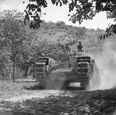 Churchill tank of 1st Canadian Armoured Division advancing towards the Gothic Line 26 August 1944