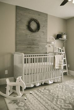 This scaled back wood pallet wall is perfect in this woodland baby boy nursery!