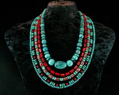 Love the multi strand look...made one with the same oval flat turquoise, used Tibetan brass inlayed beads and round coral beads.  Beautiful if I do say so myself!