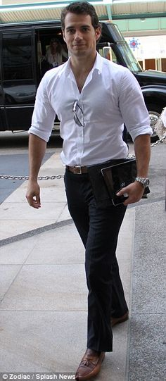 Man of steel: British actor Henry Cavill looks smart in a white shirt and jeans as he returns to his hotel following his Superman panel