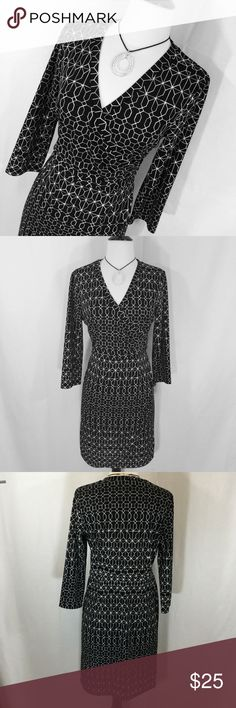 Black and white geometric print faux wrap dress Gorgeous faux wrap dress in black and white geometric print from The Limited size medium. Polyester knit. EUC 35 inches long 18 inches armpit to armpit 30 inch waist 38 inch hips The Limited Dresses Midi