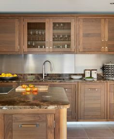 Contemporary cabinets with inset doors by Davonport, UK. Love the woodtones with the stainless steel backsplash