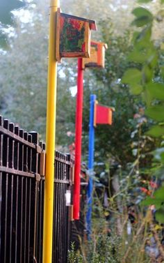 colorful birdhouse posts--off the back of the fence? Colorful addition, made by dbc or girl's group next year?