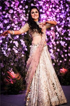 An Anamika Khanna Ivory and baby pink Lehenga with Gold Leaf work for the Sangeet ceremony of Real Bride Shereen Sikka of WeddingSutra.