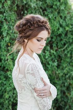 Boho bride with braided wedding hair and earthy toned makeup | Lola Images | See more: http://theweddingplaybook.com/22-stunning-wedding-dresses-for-every-bridal-style/