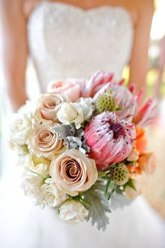I like that this bouquet uses traditional soft colors with unusual flowers