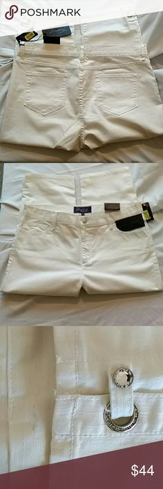 """Not Your Daughters Jeans Rhinestone NYDJ Capri New w/ Tags NYDJ White Capri w/Rhinestone Accent Measurements are approximate as follows  Waist measured flat across top no dip 18-1/4""""  Hips flat across bottom of zipper 21-5/8""""  Front Rise 11-1/2"""", inseam 21"""", leg opening 8-1/8"""" Have some kind of mark on hip shown in 3rd pic next to where rhinestone accent on leg is shown and may have other light dirt marks i possibly overlooked although i have gone over with lint roller many times…"""