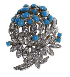 A CABOCHON TURQUOISE, DIAMOND AND GOLD FLOWER BROOCH, BY HOUSE OF TAYLOR Set with oval and round cabochon turquoise and approximately 99 circular, baguette and marquise-cut diamonds weighing approximately 7.00-8.00 carats total, G/H color, VS-SI clarity, mounted in 18k white and yellow gold, shows signs of normal wear, overall condition good Signed Elizabeth for House of Taylor
