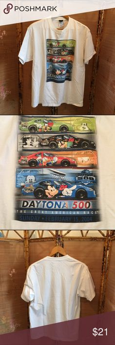"""NASCAR short sleeve 2004 tee shirt GUC NASCAR 100% cotton white 2004 Daytona 500 pace car tee shirt. Front has horizontal car bars with Goofy, Pete, Donald, and Mickey in green, black, red, and blue. """"Daytona 500 the Great American Race Sunday • February 15, 2004"""" is right below. Back is solid white. All items come from a smoke free home. Measurements available upon request. All questions are welcome. Daytona Shirts Tees - Short Sleeve"""