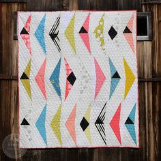 I just finished this quilt that I am calling Wings. While designing it, I found myself referring to the elongated triangles as wings, and the black triangles that are present in some of the triangle s