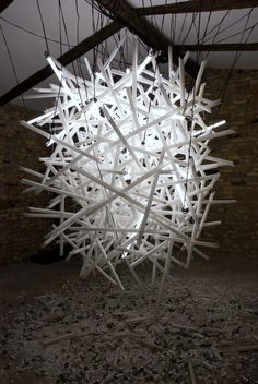 Hitoshi Kuriyama creates elaborate light installations using complex clusters of shattered fluorescent light bulbs.