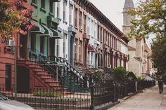 The colorful look of Bushwick, all lined up in a row. The door under the stoop goes to the cellar.