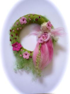This Fairy wreath with is Needle Felted.  Average Diameter:10    Your purchase will be sent within 5/10 business days. If you need something to be