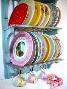 A colorful collection of vintage dishes is stored out in the open for all to see...such a great idea!   houzz.com