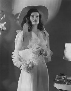 """""""Katharine Hepburn in The Philadelphia Story, when she weds Cary Grant's character. I love her minimal makeup and fun curly hair, perfectly pinned back behind her ears."""" —Brooke Danielson, Vogue.com Accessories Editor"""