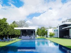 Outside, A-Rod and his family can take full advantage of the Florida weather with this pristine saltwater pool, which is inset into the artificial lawn. (Bjorn Wallander for Architectural Digest)  via @AOL_Lifestyle Read more: http://www.aol.com/article/2016/05/09/take-a-look-inside-a-rods-modern-miami-home/21373683/?a_dgi=aolshare_pinterest#fullscreen