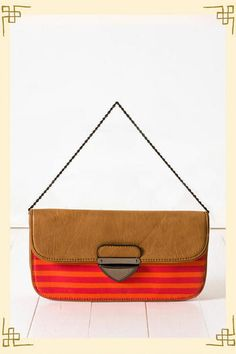 like this purse! But LOVED the one that had black and white stripes! Wish I had scooped it up when I had the chance!