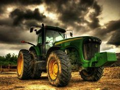 Tractor for the muddy roads on the reservation, cool wheels, cloudy sky, field view, panorama setting, vehicle, traktor, photo