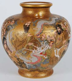 Impressive Satsuma Pottery Vase. Meiji Period. Signed and with Prince of Satsuma Seal. Decorated with immortals and dragon with raised scales.