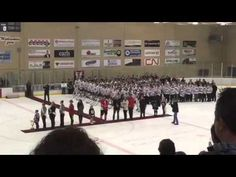 15 year old Hungarian Hockey Player sings National Anthem after PA failure