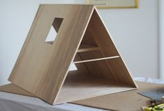 A-frame dollhouse--easy to make from cardboard or balsa wood.
