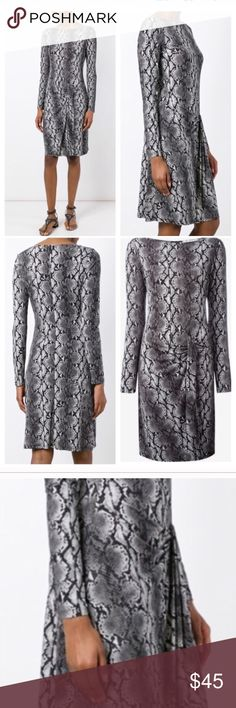 Michael Kors Long Sleeve Dress Python print Gorgeous and flattering with lots of stretch. Micheal Kors Python print, Long sleeve dress features sash at waist. Worn one time. Adorable with tights/boots. In flawless, like new condition from a pet/smoke free home. MICHAEL Michael Kors Dresses Long Sleeve