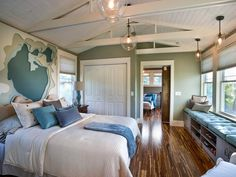 The master bedroom in soothing hues features a vaulted ceiling and gorgeous views of Lake Hamilton.