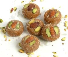 For many of us who are basically foodies and food enthusiast, simply listening to the name of Mathura Peda waters our mouths. Here is some details you'll love to know about your favorite Mathura Peda, the north indian delicacy. India Online, Indian Sweets, Sweets Online, Deserts, Cooking, Breakfast, Mouths, Powdered Sugar, Gifts