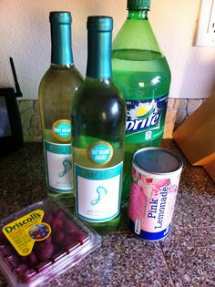 Summer Punch - 2 bottles Moscato, 1 can of pink lemonade concentrate, 3 cups of Sprite, 1 container of fresh raspberries      well this will be made...