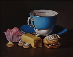 Blue tea cup with Mr Kipling cakes and iced gems framed