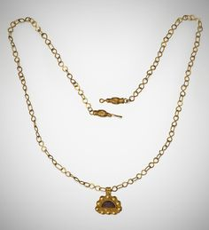 Roman gold and garnet pendant on a gold link chain c 3rd - 4th century AD