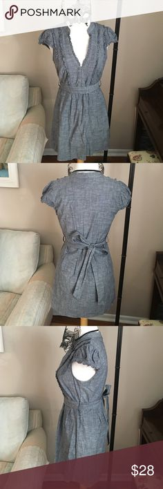 Fei chambray dress This dress is chambray material with a sinched waist and tie belt. The front is pretty low cut with ruffles and buttons on it. 30 inches long from the top. Fei Dresses