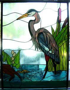 i really like this heron, especially the irridescent and purple glass. however the vacant eye ruins what could be a really great piece. $575
