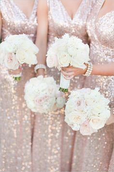 Bridesmaids dresses in blush sequins with white rose bouquets, we're blushing just looking at it!