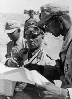 Field Marshal Erwin Rommel, Commander of the German forces in North Africa, confers with his aides during the Western Desert campaign, 1942-43. Rommel always led from the front, something that made his staff nervous. But the field marshal found no other way of being aware of the details of the situation -- and he was finally defeated in a battle with illness rather than his enemy.